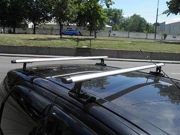 Багажник на Suzuki SX4 в штатные места Kenguru